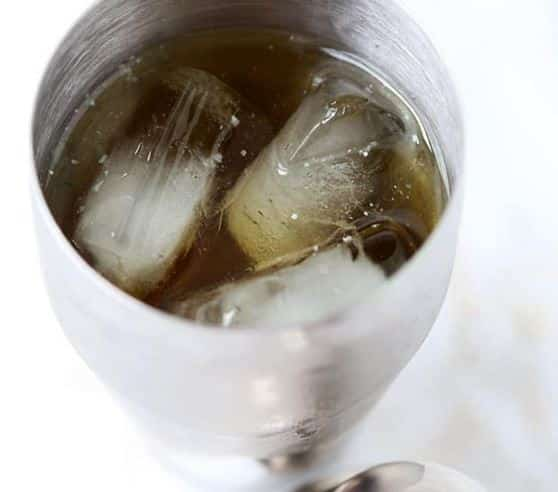 Green tea shot with ice cube